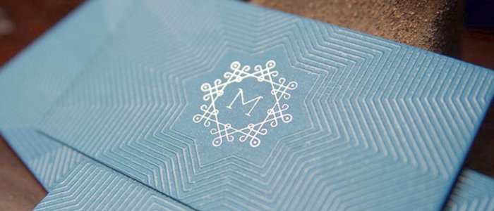 An elegant, foil-stamped business card with Spot UV lamination