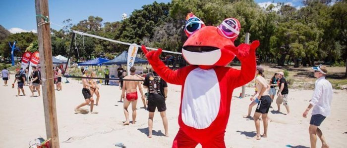 Red Frogs' Official Mascot on the beach